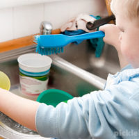 Easy sensory play idea for kids - washing dishes in the sink