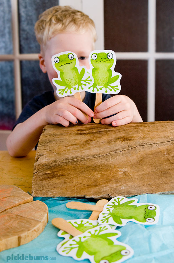 Five green and speckled frog puppets