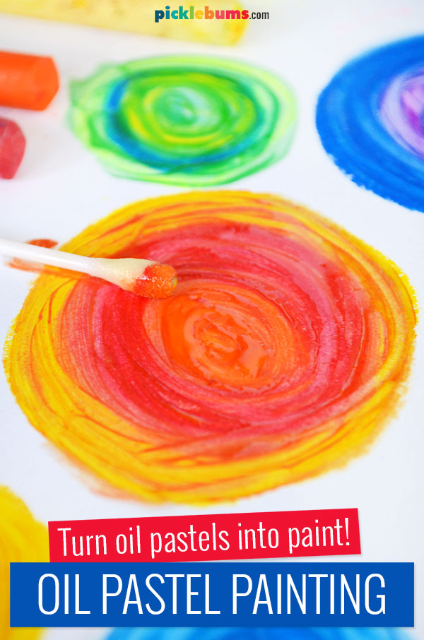 bright colourful circle of oil pastel turned into paint with oil and cotton bud