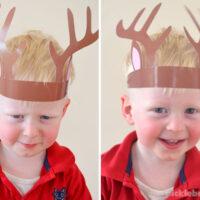 toddler wearing reindeer antler hat and making faces