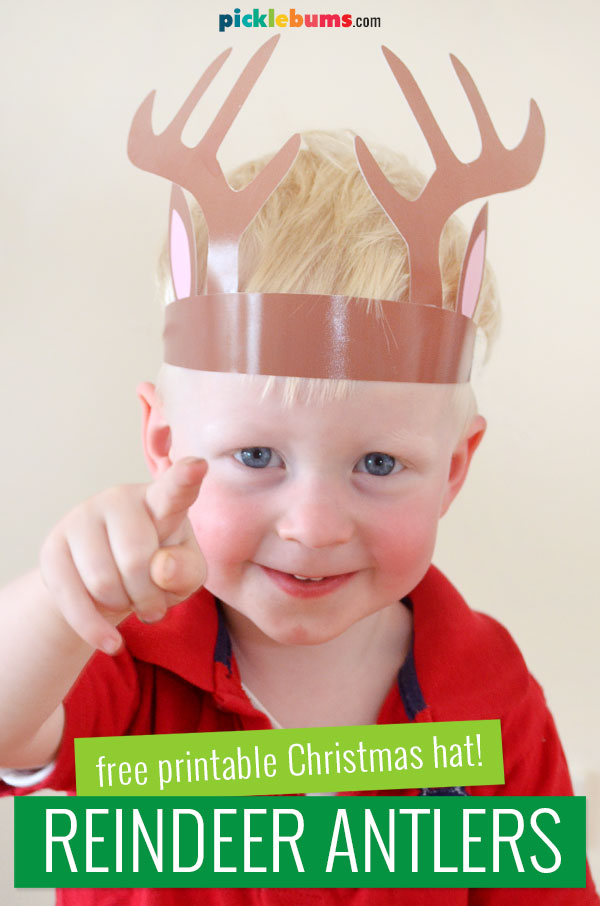 toddler wearing printable reindeer antlers