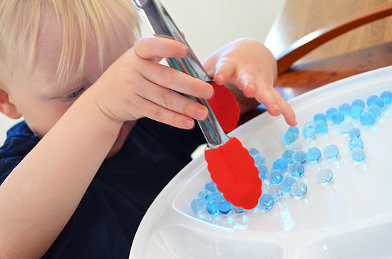 Fine motor activities tongs and water beads