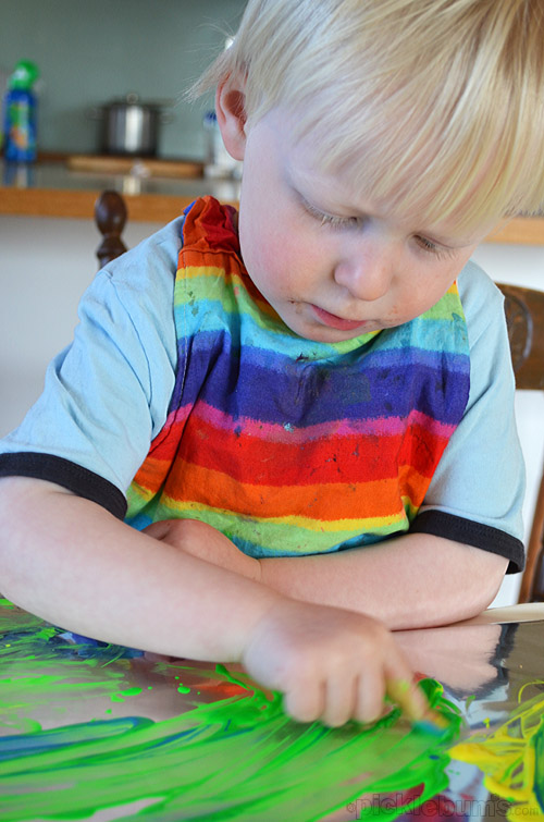 Finger Painting on Foil! Super easy art activity.
