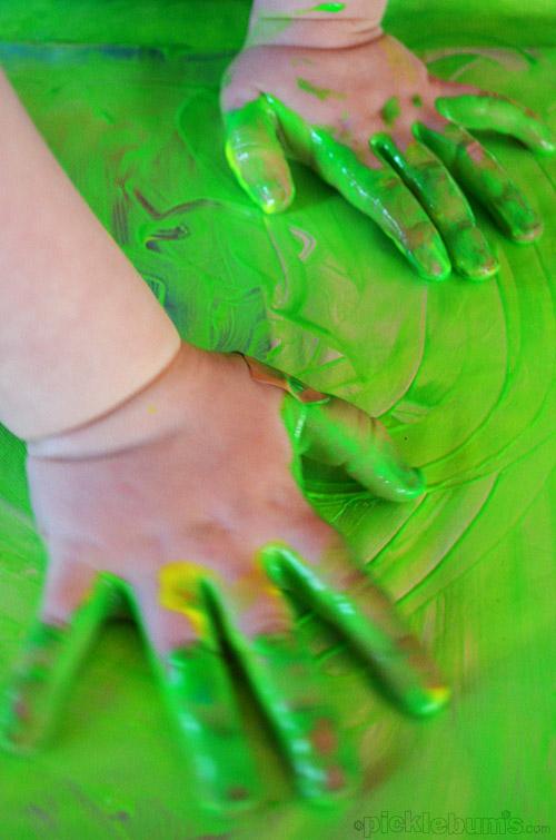 Finger Painting on Foil! Slippy slidey fun!
