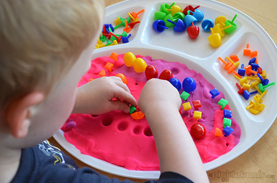 Six More Simple Play Dough Activities - play dough and peg board pegs