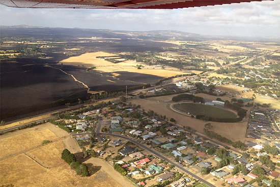 This areal photograph was taken by a friend and looks over the town towards the blackened paddocks after the fire
