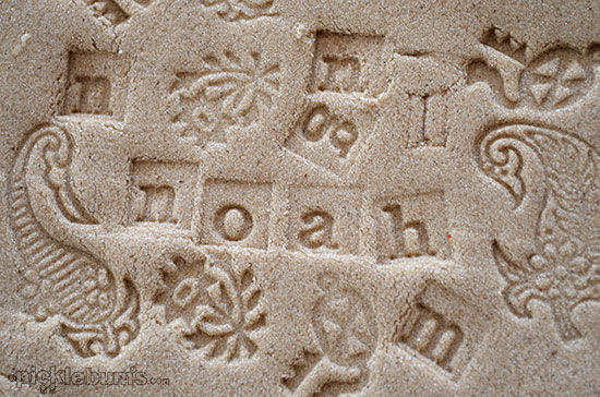 Stamping fun with kinetic sand