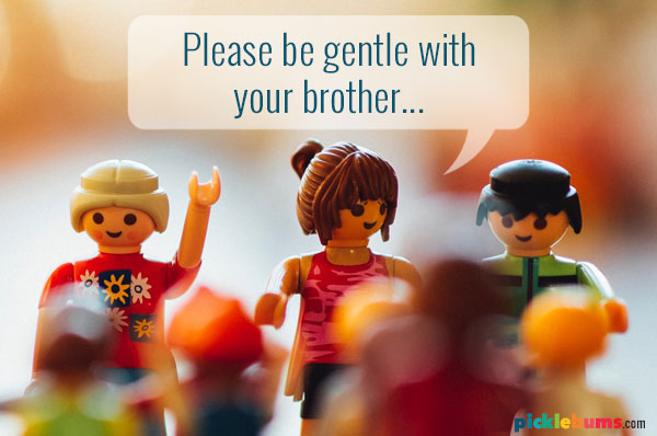 Playmobil figurines with a speech bubble saying please be gentle with your brother