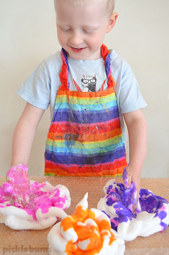 It might look messy but this is one of the quickest, and easiest, sensory play set ups you'll ever try!