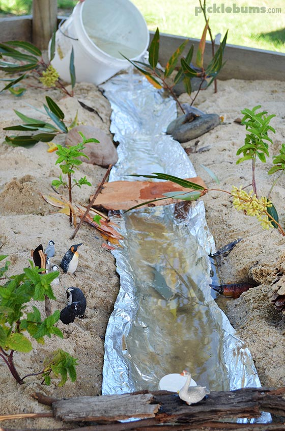 Make a River - imaginative play in the sandpit!
