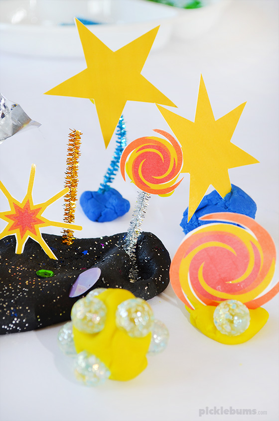 Space Place Dough! Try out soft stretchy space play dough recipe and our free printable star accessories, plus more space themed play dough ideas!