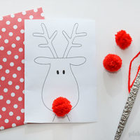 Make a cute reindeer card and add a funny pom pom nose! Free printable card and template