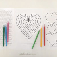 three heart colouring pages and coloured markers