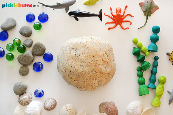 sand play dough surrounded by sea creatures and other items