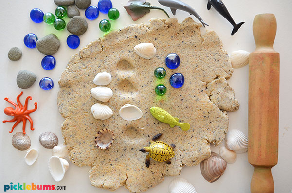 sand play dough with shells, fish and gems