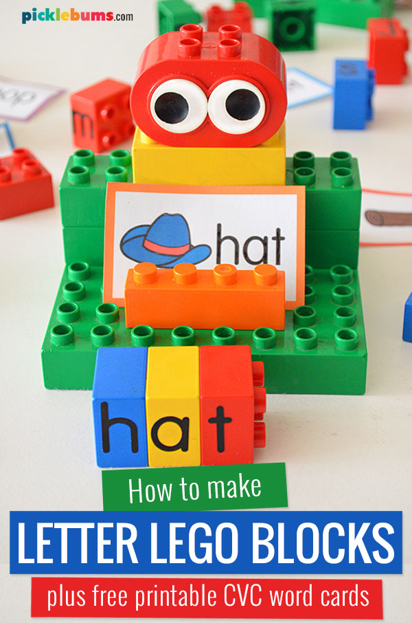 duplo blocks with letter stickers and cvc word cards on stand