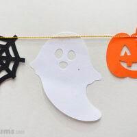 paper hallween shapes attaches to garland string