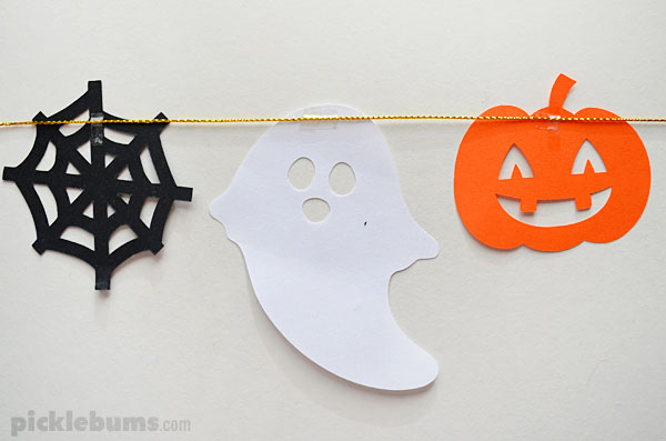 paper Halloween shapes attaches to garland string