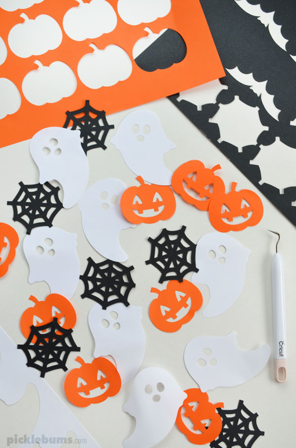paper cut out halloween pumpkins, webs and ghosts