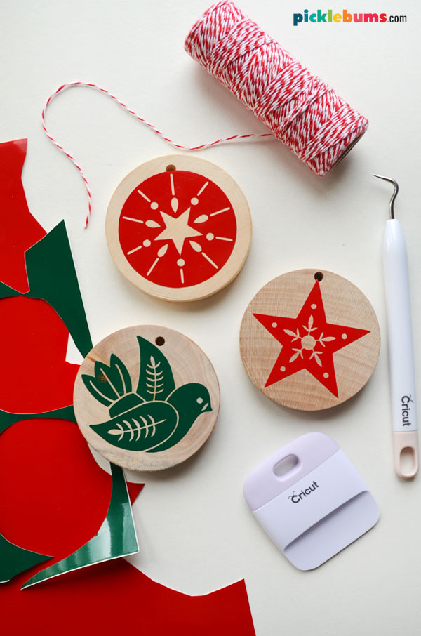 wood slice ornaments with supplies to make them