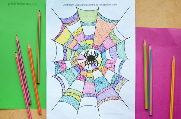 spider colouring page and pencils